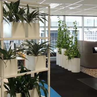 WIRE WALL IN ROUND PLANTERS AT KPMG